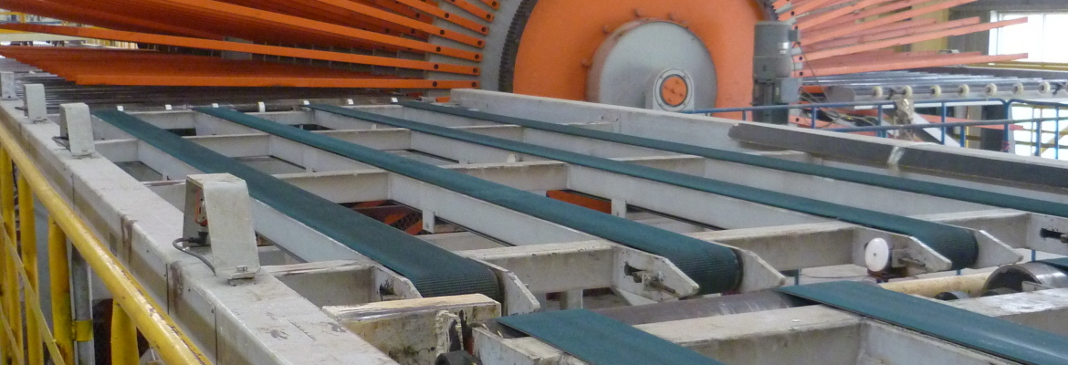 After the boards have been pressed, they are transported to a huge cooling wheel, also known as the star winder, to be cooled down (the air cools them) and turned over.