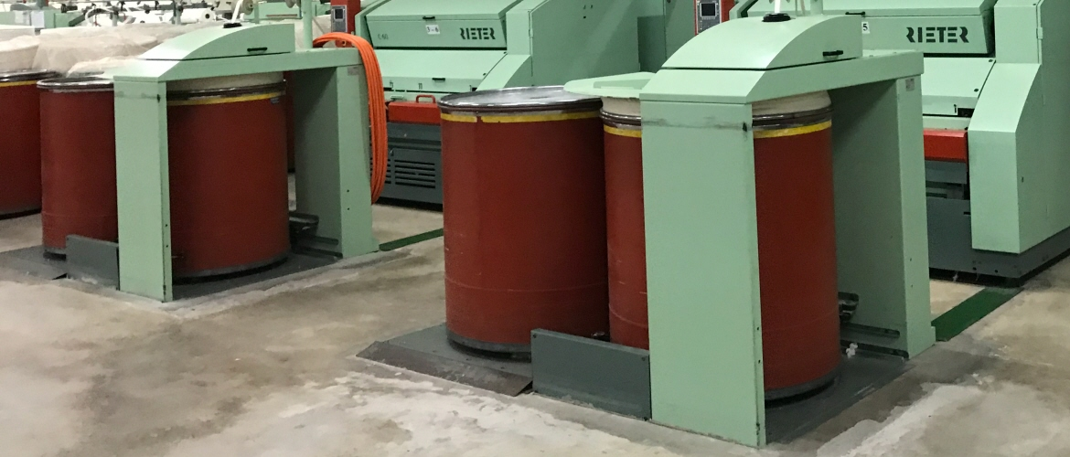 Carding machines align lose fibres into tufts or fleece. Carding machines are driven by power transmission belts and have sliver tapes installed to guarantee a frictionless output of the carded sliver out of the machine.